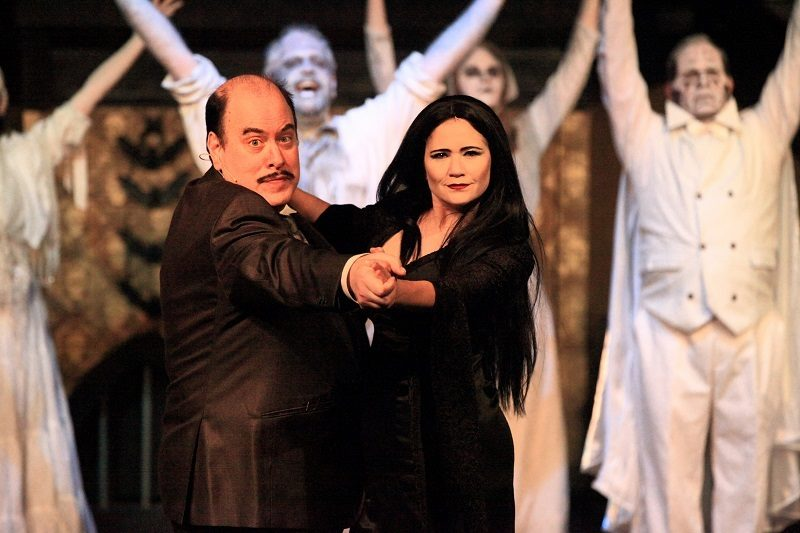Gomez and Morticia dancing with Ancestors